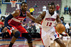Feb 13, 2013; Auburn Hills, MI, USA; Detroit Pistons point guard Will Bynum (12) drives past Washington Wizards point guard John Wall (2) during the fourth quarter at The Palace. Detroit won 96-85. Mandatory Credit: Tim Fuller-USA TODAY Sports