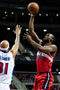 Feb 13, 2013; Auburn Hills, MI, USA; Washington Wizards center Emeka Okafor (50) shoots over Detroit Pistons power forward Charlie Villanueva (31) during the first quarter at The Palace. Mandatory Credit: Tim Fuller-USA TODAY Sports