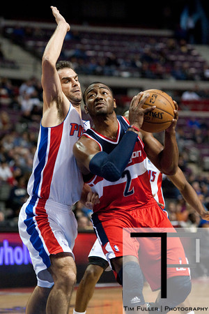 Feb 13, 2013; Auburn Hills, MI, USA; Washington Wizards point guard John Wall (2) drives to the basket against Detroit Pistons point guard Jose Calderon (8) during the first quarter at The Palace. Mandatory Credit: Tim Fuller-USA TODAY Sports