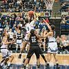 Nina Bessolo grabs a rebound