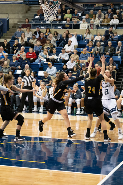 Katie Toole drives to the hoop