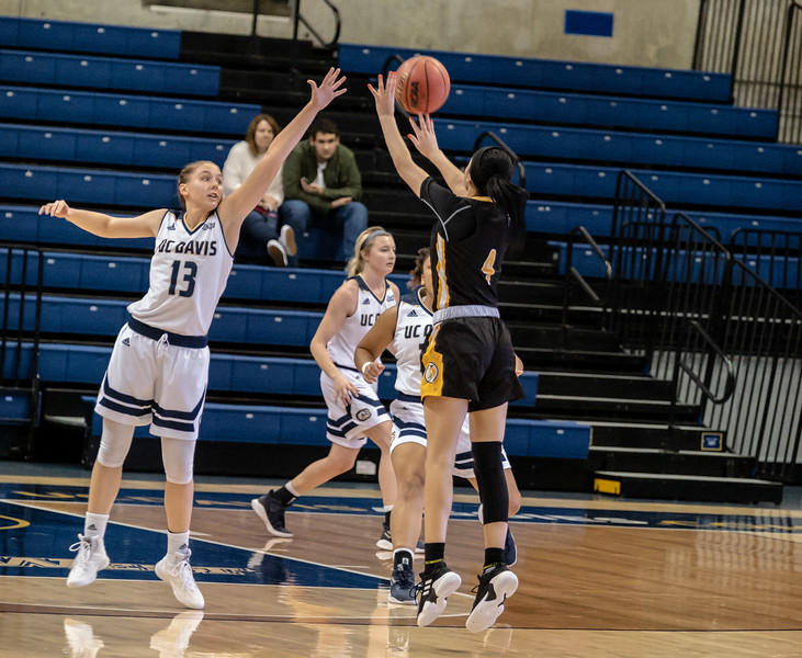 Katie Toole defends a 3 pointer