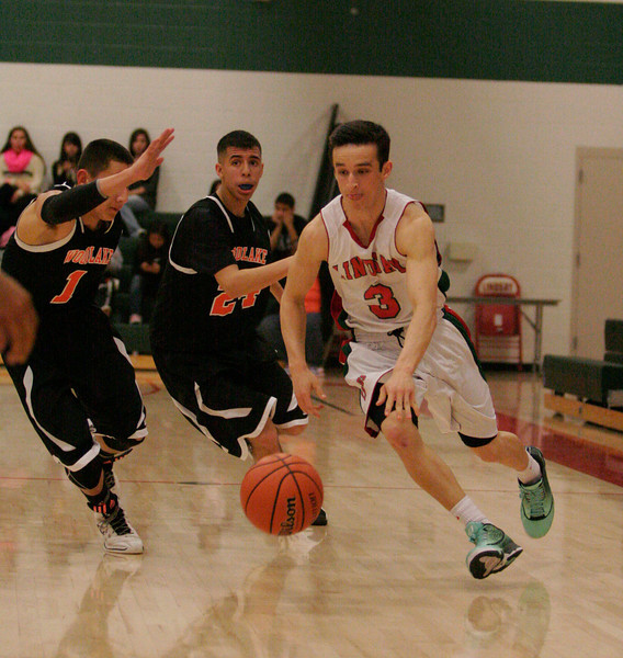 Lindsay Cardinal Gavin Mann (3) scored 20 points in the Cardinals' 61-56 win at home over the Woodlake Tigers.