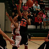 Woodlake Tiger forward Jorge Tafola (22) grabs a rebound at Lindsay High School in Thursday's contest.