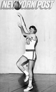New York Knicks John Gianelli strikes pose. 1975