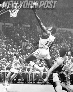 Willis Reed soars over Wilt Chamberlain for a basket. 1970