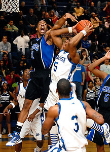 03-03-10  --campbell at mceachern 01--  McEachern's Marquis Roberts (5) goes up for the basket and draws the foul from Campbell's Roderick Perkins (1) on Wednesday night.  STAFF/LAURA MOON.