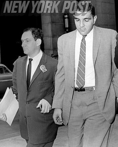 Dan Quindazzi leaving D. A's office with Detective on way to be booked at Elizabeth St. station. 1961