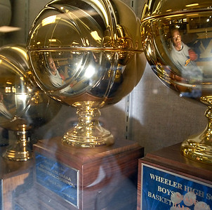 Phil Taylor looks at past state basketball trophies in hopes of earning one this year for Wheeler High School.