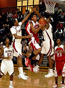 12-13-08  --osborne at hillgrove 2--  Osborne's Devonte Thornton, center, attempts a shot through Hillgrove's defense on Saturday night.  PHOTO BY LAURA MOON.
