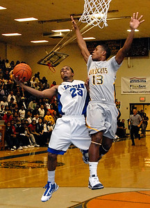 02-09-10  --wheeler at campbell 05--  Campbell's Justin Seymour (23) goes up against Wheeler's Derrick Frye (13) on Tuesday night.  STAFF/LAURA MOON.