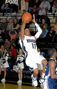 Wheeler's Phil Taylor hovers in the air before making his shot Thursday night against Northview High School.