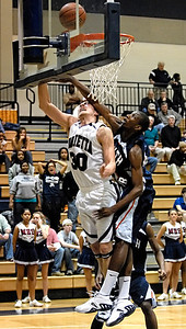 Marietta's J.C. Ward (30) takes a shot and gets the foul from South Cobb's Jacob Pettway (33) Tuesday night.
