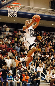 3-07-09  --norcross at wheeler 1--  Wheeler's Ari Stewart goes up for the dunk against Norcross on Saturday night.  PHOTO BY LAURA MOON.