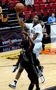 KSU's Greteya Kelley (11) takes a shot against Jacksonville's Virginia Gregoire (32) Monday night.