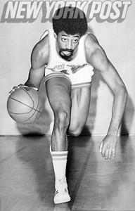 New York Knicks Dennis Bell dribbling. 1975