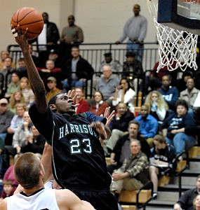 Harrison's Vince Martin prepares himself for a dunk against Marietta Tuesday night.
