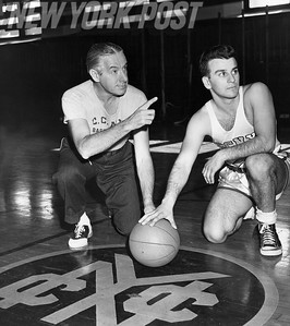 """""""Mr. Basketball"""" coach, Nat Holman, with team captain, Lou Berson, for the City College of New York. 1955"""