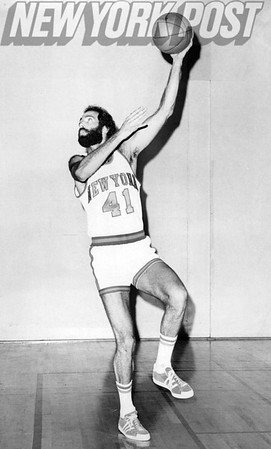 New York Knicks Neal Walk posing after tossing Basketball. 1975