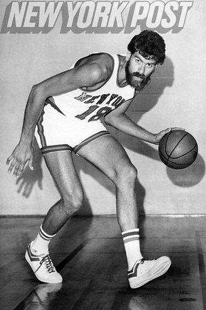 New York Knicks Phil Jackson striking pose with basketball. 1975