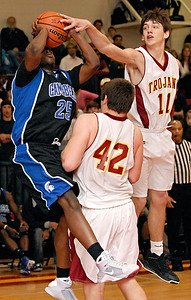 1-09-09  --campbell at lassiter 3--  Campbell's John Massie (25) gets blocked by the defense of Lassiter's Daniel Garza (11) and Phillip Lutzenkirchen (42).  PHOTO BY LAURA MOON.