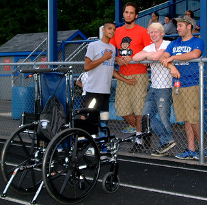 Christopher Aune | The Herald-Tribune Bulldogs manager Nick Schneider (from left), a sophomore, talks with friends former BHS student Torri Jackson and BHS graduates Jagger Cozart and Brandon Doyle as they watch the scrimmage. Schneider recently had knee surgery and continues to watch after equipment, usually from his wheelchair.