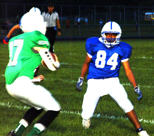 Christopher Aune   The Herald-Tribune<br /> A Triton Central receiver catches a pass and turns to find sophomore Matt Thomas bearing down on him.