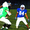 Christopher Aune | The Herald-Tribune<br /> A Triton Central receiver catches a pass and turns to find sophomore Matt Thomas bearing down on him.