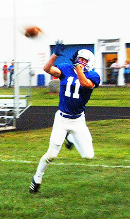 Christopher Aune | The Herald-Tribune Senior Pete Heil catches a touchdown pass after maneuvering out of reach of a Triton Tiger.