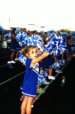 Christopher Aune | The Herald-Tribune Five-year-old Alexis Hinds leads dozens of aspiring cheerleaders who came out for Youth Football Night at the first home game.