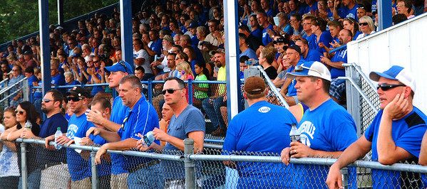 Christopher Aune | The Herald-Tribune<br /> An estimated crowd of more than 600 fans in blue came out to cheer on the Bulldogs on a humid night.