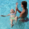 Diane Raver | The Herald-Tribune<br /> PROGRESS: One little girl gets comfortable floating on her back.