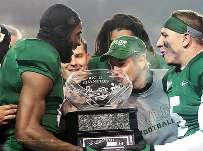 Coach Art Briles kissing the Big XII Championship trophy on the field at the closing of Floyd Casey Stadium when Baylor defeated The University of Texas to win the championship outright. Thank you Coach Briles. Go Bears.