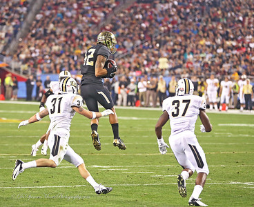 Levi Norwood leaps high in the air to catch a Bryce Petty pass in the Fiesta Bowl.