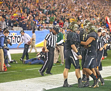 Mark Randolph gets run over in the Fiesta Bowl game and ends up on the ground as a defensive player runs out of bounds in pursuit of Bryce Petty as he ran for a touchdown. Mark was OK and sustained no injuries at all. He was proud to live thru the incident.