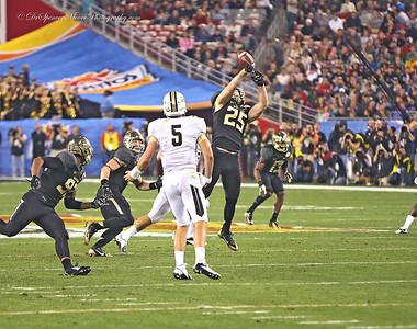 Sam Holl jumps high to deflect a pass from UCF quarterback and the ball ended up being intercepted by Eddie Lackey.