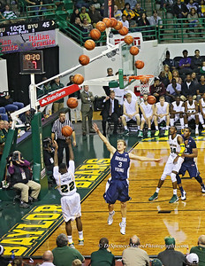 A.J. Walton making a 3 pointer from the corner.  A sequence of shots shows the ball's track to the basket.
