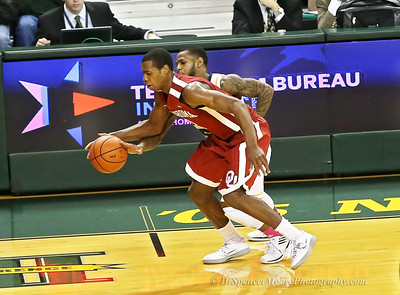 Pierre Jackson reaching in for a steal from this OU player. Pierre is a slick one on defense.