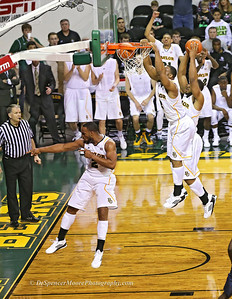 This is a composite shot of Rico Gathers dunking a shot against West Virginia here in Waco.