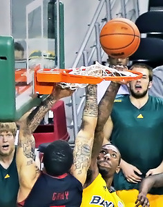 You can see the defensive players fist pushing the net upward as he knocked the ball out of the basket and back in the air. It took 2 different players working to get the net freed from the rim after the play was over.