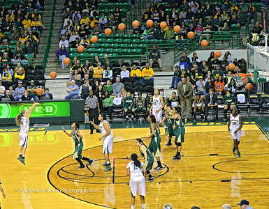 Makenzie Robertson makes a three-pointer from the NBA  three point area which is 3 feet farther back than the NCAA line as you see drawn on Baylor's court. She has become known for her three pointers and the crowd burst into cheers when she popped this one.