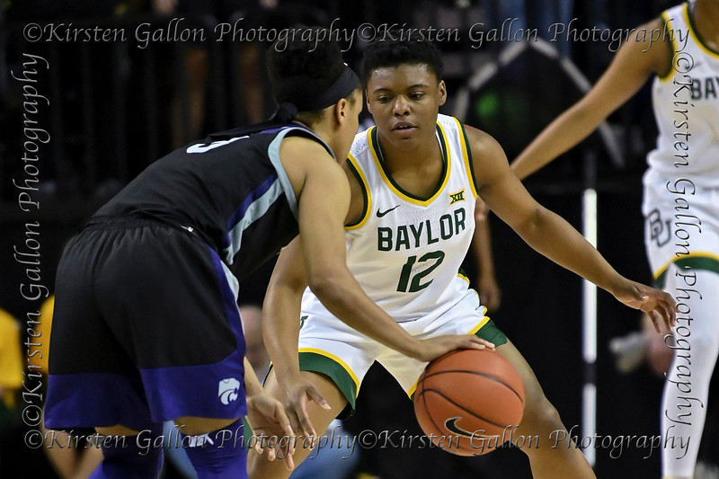 Baylor guard Moon Ursin defends against K State guard Angela Harris.