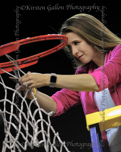 Makenzie Fuller, Associate Director of Operations, finds the perfect spot to make her cut of the net.