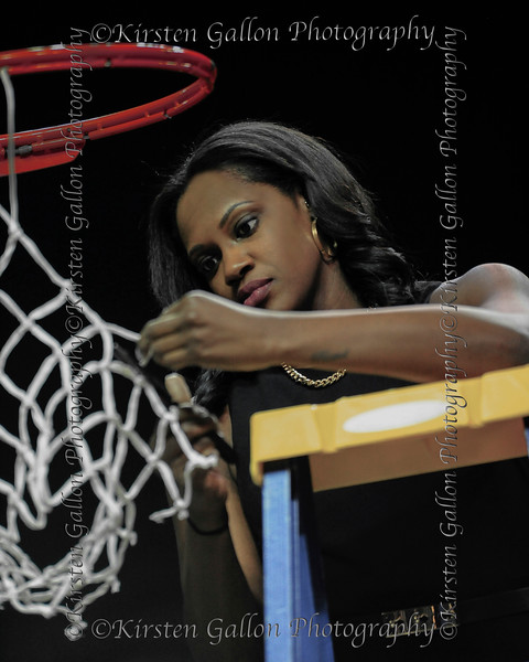 Daphne Mitchell, Assistant Coordinator of recruiting and operations gets to take her turn at cutting the net.