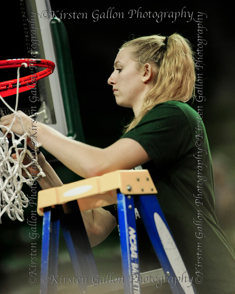 Lauren Cox takes her turn at cutting down the net.