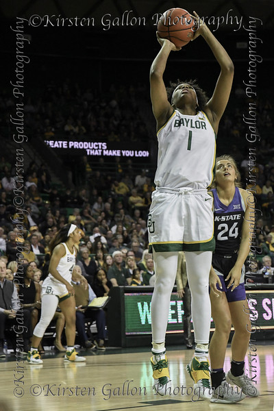 Baylor forward NaLyssa Smith goes up for the shot as K State forward Emilee Ebert looks on.