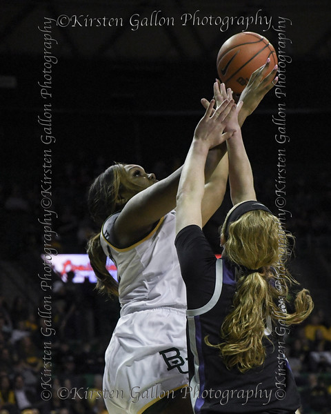 Erin DeGrate goes up for the shot against the out-stretched arms of K State forward Laura Macke.