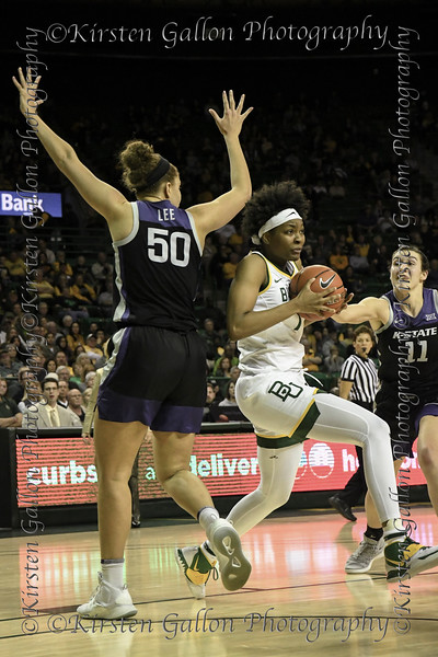 Baylor forward NaLyssa Smith heads to the basket between two K State defenders, #50 Ayoka Lee and #11 Peyton Williams.