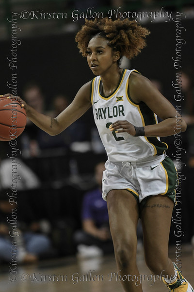Baylor guard, #2 Didi Richards brings the ball up the court.