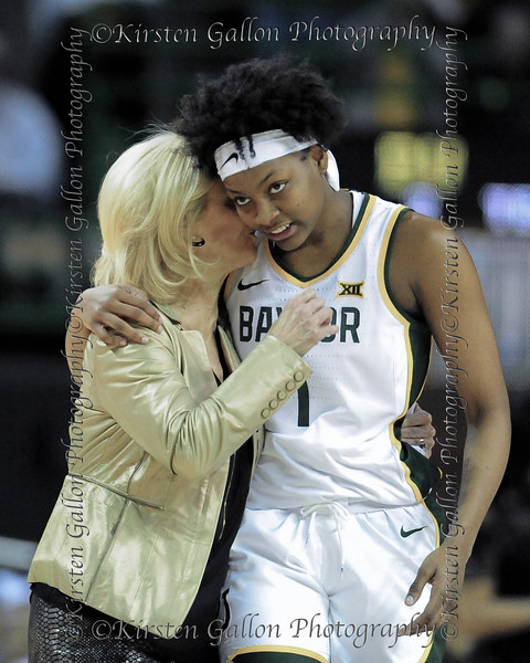 Coach Kim Mulkey talks over a strategy with forward NaLyssa Smith.